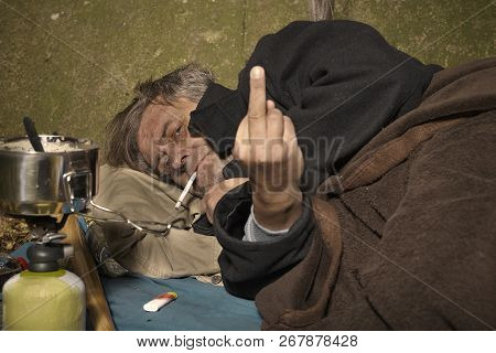 Ugly Pauper Man Living Outdoor Sleeping, Relaxing And Laying Alone On Hidden Urban Place