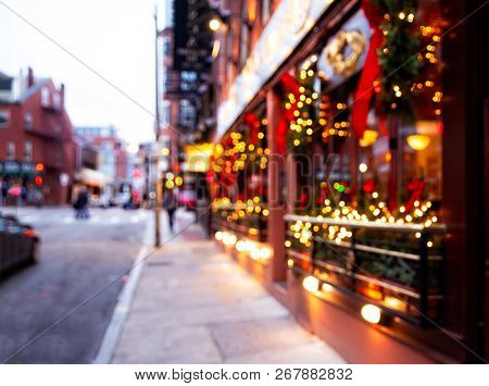 City Street With Christmas Illuminations. Blurred Background. Christmas Lights And Christmas Decorat