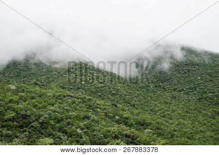 Group of mountains surrounded by haze, beautiful natural landscape. poster