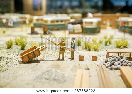 Japanese Workers In Miniature Models Of 1800's On Blurry Ancient Worker Camps. Show In The Osaka Mus