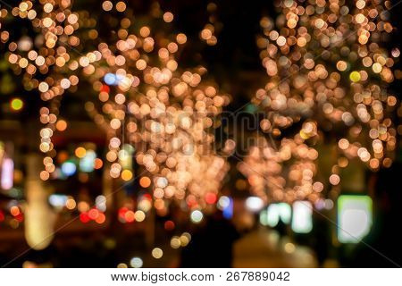Blurred And Bokeh Of Led Refection Lighting Decorate On Trees With City Night Life In Osaka, Japan.