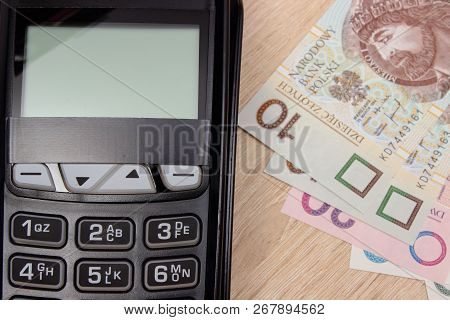 Credit Card Reader And Polish Currency Money, Payment Terminal, Finance And Banking Concept