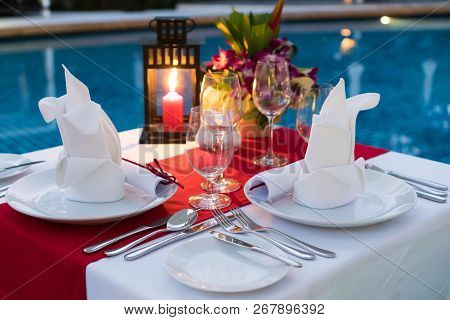 Romantic Candlelit Dinner Table; Poolside With Table Set