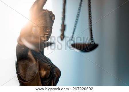 Statue Of Justice With Scales In Lawyer Office. Legal Law, Advice And Justice Concept