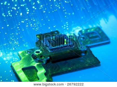 CCD sensor on a card of digital camera with fiber optical background poster