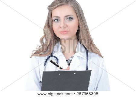 Attentive Female Doctor Writes A Prescription .isolated On White