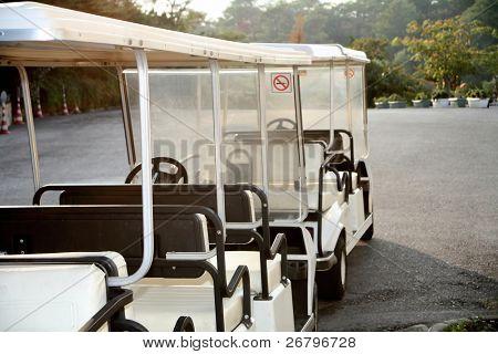 close up shot of several white golf carts