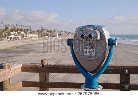 Coin-operated Binoculars Overlooking The Beach From A Pier In Oceanside, California, Usa