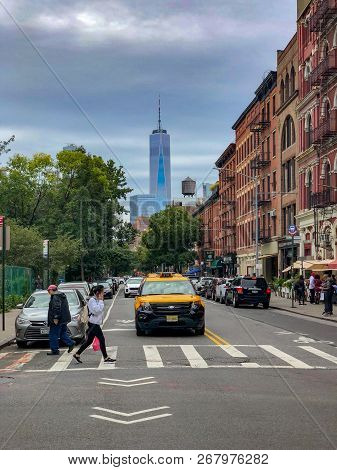New York City - October 14, 2018: View Of A Taxi And World Trade Center In The Greenwich Village Nei
