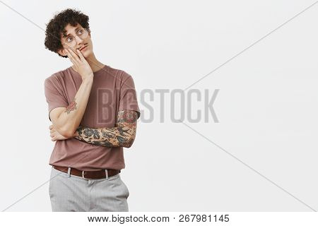 Man Sighing Feeling Bored Thinking What To Do. Indifferent Gloomy Handsome White Male With Moustache