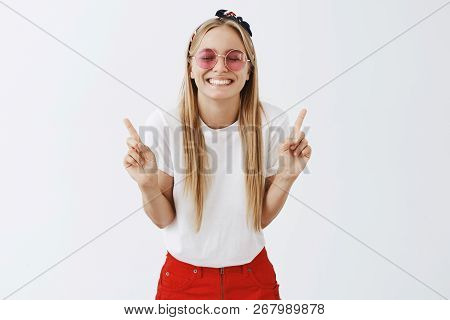 What Pleasure Being Number One. Portrait Of Grinning Optimistic And Playful Young Blond Woman In Sun