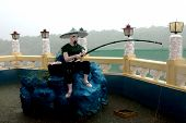 Fisher man Statue Taoist Temple Cebu in Philippines poster