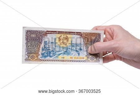 Female Hand Holding A 500 Kip 1988 Banknote Currency Isolated On A White Background. Denomination Of