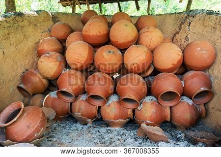 Clay Pots Are Arranged In Potter's Pot Burning Chimney With Ashes. Soil Made Pots Are Isolated After