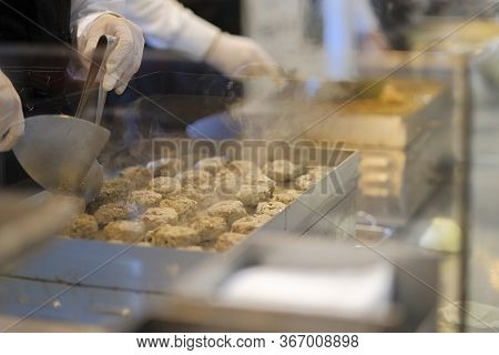 Cooking Meatballs On The Grill. Meatballs Are Grilled. Grilled Cutlets. The Cook Fries The Meatballs