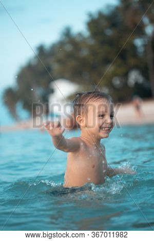 little boy frolic in the sea