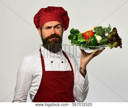 Chef Presenting Healthy Food Vegetarian Salad Isolated On White Background.