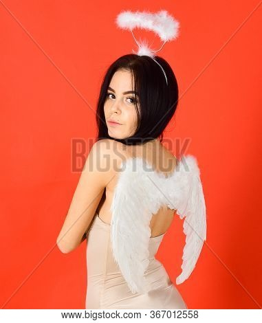 Girl In Bodysuits Looks Slim, Tender, Pure, Innocent. Lady Sexi Dressed As Angel, Red Background. Se