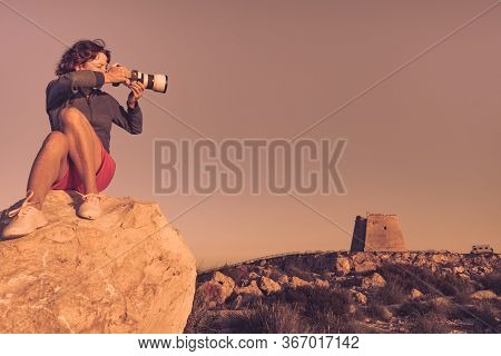 Female Tourist With Camera Taking Travel Photo From Mesa Roldan Watchtower, Cabo De Gata Nijar Natur