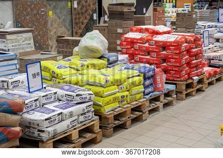 Minsk, Belarus - May 16, 2020: Building Materials Are Sold In A Hardware Store. Bags Of Cement, Plas
