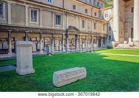 Verona, Italy, September 12, 2019: Ancient Roman Empire Ruins On Green Lawn Of Courtyard Museo Lapid