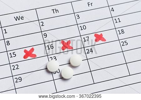 Pills For Pain During Pms On The Calendar. Close Up.