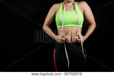 Fat Woman, Obese Woman Hand Holding Excessive Belly Fat Isolated On Dark Background, Overweight Fatt