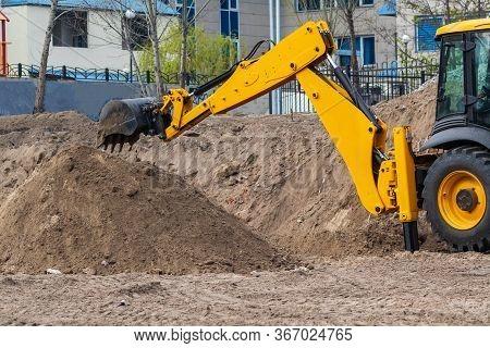 Excavator Loader During Earthworks At A Construction Site. The Excavator Is On The Construction Of A
