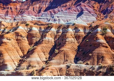 Arizona and Utah, USA. Huge slopes of red sandstone, striped from various inclusions of rocks. Paria Canyon-Vermilion Cliffs Wilderness Area. The concept of active, extreme and photo tourism