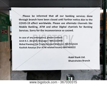 Bhairahawa, Nepal - May 09 2020: Notice On The Entrance Gate Of A Bank To Notify Customers About The