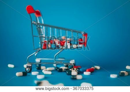 Red Basket With A Bunch Of Pills On A Blue Background