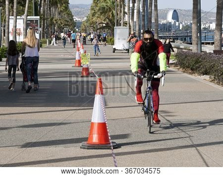 Limassol, Cyprus, May 13th, 2020: Seafront Promenade Molos With People Moving Along Red And White St