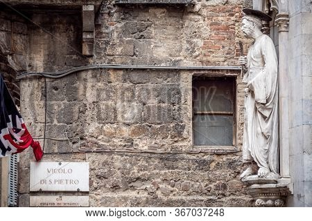 Siena, Italy, April 2018: Statue Of Saint Peter By Vecchietta. Statues Decorating Facade Of Loggia D