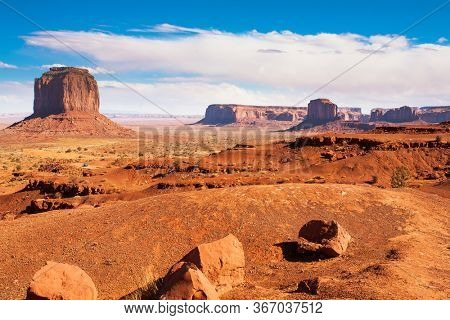 Monument Valley is unique geological formation. Huge masses of red sandstone - outliers on the Indian Navajo Reservation. USA. Concept of active and photo tourism