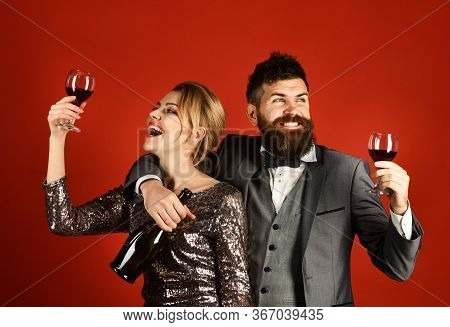 Lady And Gentleman Celebrating With Merlot Wine. Corporate Party Concept