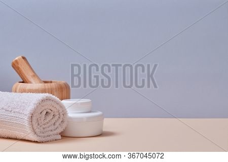 Spa. Wellness Concept. White Towel And Equipment For Relax. Selfcare. Copy Space. Isolated On Pink A