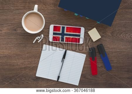 Norwegian Flag, Textbook, Smartphone, Wireless Headphones Foreign Language Learning Concept