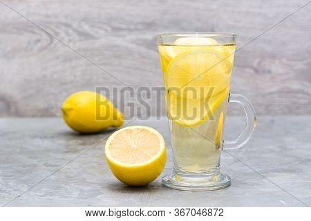 Refreshing Lemon Drink On The Table. Alternative Medicine