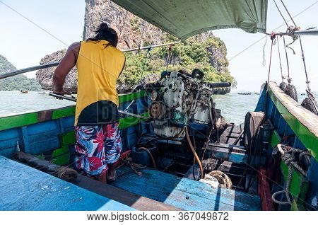 Motor Control In Thai Longtail Boat, Thailand.