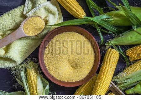 Small Corn Grits In A Bowl And Rocked Corn On The Table