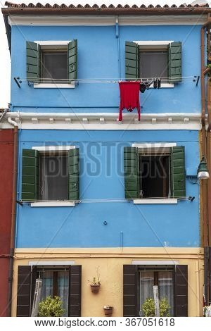 The Facade Of A Blue House With A Laundry Rack Outside In Burano, Venice, Italy: May 21, 2019. Buran