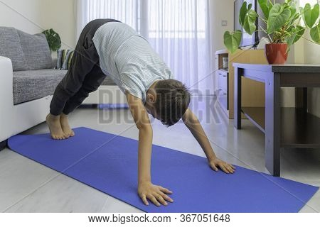 Child Doing Sport Exercises, Practicing Yoga At Home. Sport, Healhty Lifestyle, Active Leisure For K