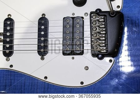 Blue White Electric Guitar. Electric Guitar Close-up With Selective Focus. A Part Of Electric Guitar