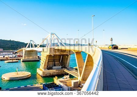 Porta D'europa, A Bascule/ Basculant Mobile Bridge At The Entrance To The Port Of Barcelona, Spain,