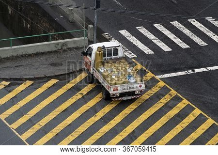 Truck With Butane Gas Cylinder Distributes The Product Through The Streets