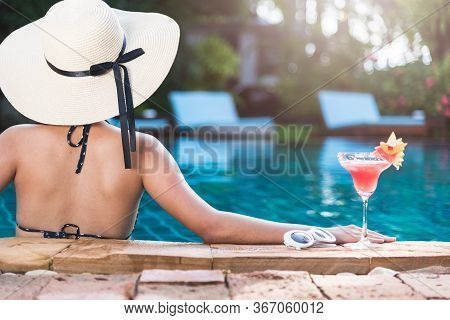 Young Back Woman In Bikini Swimming Pool Drink Cocktail, Vacation Summer Holiday Concept