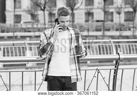 Handsome Man Mobile Phone And Coffee Cup. Modern Technology. Conversation With Friend. Call Me Later