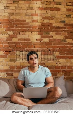 Young Mixed Race Man Chilling With Laptop Zt Home During Self Isolation
