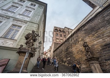 Prague, Czechia - November 2, 2019: Tourists Climbing The Old Castle Stairs, Also Called Stare Zemec