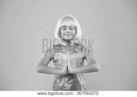 Little Asian Girl Hand Praying. Small Girl Traditional Eastern Clothes. Asian Girl Yellow Hair Wig.